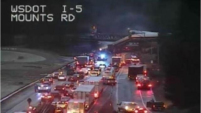 The Latest: Authorities say 13 train cars derailed