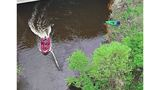 Woman clinging to tree in river is rescued after kayak capsizes, Spring Lake officials say